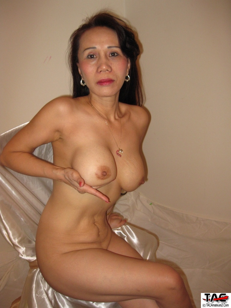 image Beautiful busty chinese girl taking a shower